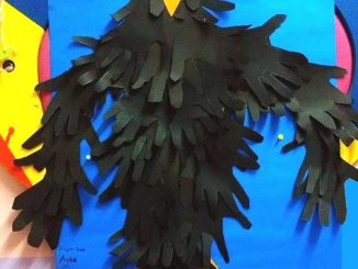 handprint crow bulletin board idea for kids